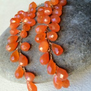 Earrings Orange Carnelian, long 14k gold fill cascades, wire wrapped, natural gemstones | Natural genuine Carnelian earrings. Buy crystal jewelry, handmade handcrafted artisan jewelry for women.  Unique handmade gift ideas. #jewelry #beadedearrings #beadedjewelry #gift #shopping #handmadejewelry #fashion #style #product #earrings #affiliate #ad