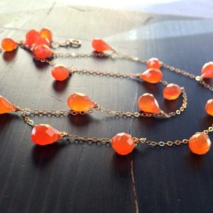 Shop Carnelian Necklaces! Orange Carnelian Necklace. Wire wrapped. Delicate chain necklace. Gemstone. Teardrop. Gold jewelry. 14k.  April birthday stone | Natural genuine Carnelian necklaces. Buy crystal jewelry, handmade handcrafted artisan jewelry for women.  Unique handmade gift ideas. #jewelry #beadednecklaces #beadedjewelry #gift #shopping #handmadejewelry #fashion #style #product #necklaces #affiliate #ad