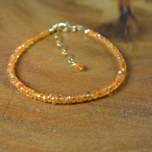 Shop Garnet Bracelets! Gorgeous Spessartine Garnet Bracelet in 14k Gold // Mandarin Orange Garnet // January Birthstone // 2nd Anniversary // Stacking Bracelet | Natural genuine Garnet bracelets. Buy crystal jewelry, handmade handcrafted artisan jewelry for women.  Unique handmade gift ideas. #jewelry #beadedbracelets #beadedjewelry #gift #shopping #handmadejewelry #fashion #style #product #bracelets #affiliate #ad