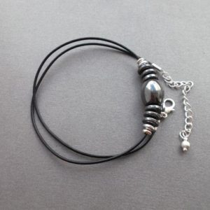 Shop Hematite Necklaces! black Hematite bead choker for men, black hematite and leather necklace, Men jewelry, gift for men, gift for guys, gift for him   Natural genuine Hematite necklaces. Buy handcrafted artisan men's jewelry, gifts for men.  Unique handmade mens fashion accessories. #jewelry #beadednecklaces #beadedjewelry #shopping #gift #handmadejewelry #necklaces #affiliate #ad