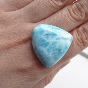 Shop Larimar Cabochons! Natural Blue Larimar Triangle Gemstone Cabochon from the Dominican Republic | Natural genuine stones & crystals in various shapes & sizes. Buy raw cut, tumbled, or polished gemstones for making jewelry or crystal healing energy vibration raising reiki stones. #crystals #gemstones #crystalhealing #crystalsandgemstones #energyhealing #affiliate #ad