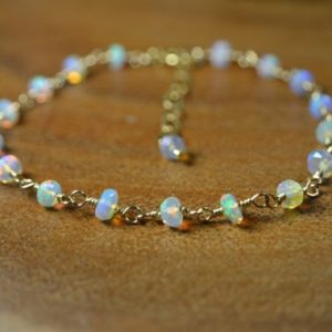 Ethiopian Welo Opal Bracelet in Sterling Silver, 14k Gold // Opal Rosary // October Birthstone // Faceted Welo Opal // 14th Anniversary | Natural genuine Opal bracelets. Buy crystal jewelry, handmade handcrafted artisan jewelry for women.  Unique handmade gift ideas. #jewelry #beadedbracelets #beadedjewelry #gift #shopping #handmadejewelry #fashion #style #product #bracelets #affiliate #ad