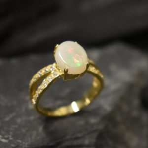 Shop Opal Rings! Opal Ring, Gold Opal Ring, Natural Opal, October Birthstone, Gold Engagement Ring, Gold Vintage Ring, Australian Opal Ring, 18k Gold Plating | Natural genuine Opal rings, simple unique alternative gemstone engagement rings. #rings #jewelry #bridal #wedding #jewelryaccessories #engagementrings #weddingideas #affiliate #ad