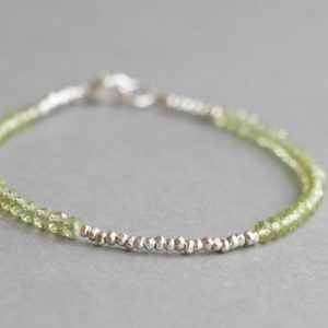 Shop Peridot Bracelets! Peridot Bracelet August Birthstone Beaded Gemstone Bracelet Skinny Bracelet Gift For Leo | Natural genuine Peridot bracelets. Buy crystal jewelry, handmade handcrafted artisan jewelry for women.  Unique handmade gift ideas. #jewelry #beadedbracelets #beadedjewelry #gift #shopping #handmadejewelry #fashion #style #product #bracelets #affiliate #ad