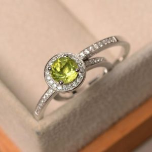 Shop Peridot Rings! Peridot ring, August birthstone ring, round cut,  bridal sets, sterling silver halo ring | Natural genuine Peridot rings, simple unique alternative gemstone engagement rings. #rings #jewelry #bridal #wedding #jewelryaccessories #engagementrings #weddingideas #affiliate #ad