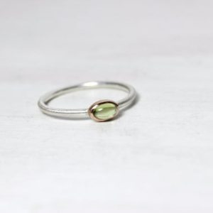 Shop Peridot Rings! Tiny Peridot Ring 14K Rose Gold Silver Boho Pale Green August Birthstone Delicate Gemstone Stackable Oval Cabochon Gem Dainty Band – Pernod | Natural genuine Peridot rings, simple unique handcrafted gemstone rings. #rings #jewelry #shopping #gift #handmade #fashion #style #affiliate #ad