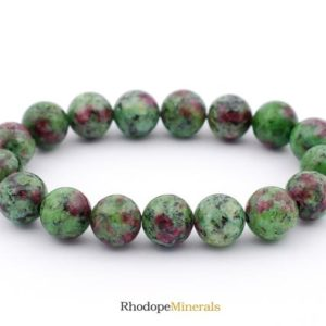 Shop Ruby Zoisite Bracelets! Ruby Zoisite Bracelet, Ruby Zoisite Bracelets, Ruby Zoisite Bracelet, 10 Mm Healing Ruby Zoisite Bead Bracelet, Ruby Zoisite Beaded Bracelet | Natural genuine Ruby Zoisite bracelets. Buy crystal jewelry, handmade handcrafted artisan jewelry for women.  Unique handmade gift ideas. #jewelry #beadedbracelets #beadedjewelry #gift #shopping #handmadejewelry #fashion #style #product #bracelets #affiliate #ad