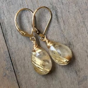 Shop Rutilated Quartz Jewelry! Golden Rutilated Quartz Earrings – petite rutile Quartz dangles. Gold drops. Yellow. Gemstone earrings. Leverbacks. | Natural genuine Rutilated Quartz jewelry. Buy crystal jewelry, handmade handcrafted artisan jewelry for women.  Unique handmade gift ideas. #jewelry #beadedjewelry #beadedjewelry #gift #shopping #handmadejewelry #fashion #style #product #jewelry #affiliate #ad