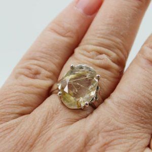 Shop Rutilated Quartz Rings! Golden rutile Quartz crystal ring faceted cut stone ring stunning oval shape cut stone cab set on solid 925 sterling silver quartz rutile | Natural genuine Rutilated Quartz rings, simple unique handcrafted gemstone rings. #rings #jewelry #shopping #gift #handmade #fashion #style #affiliate #ad