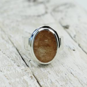 Shop Rutilated Quartz Rings! Love at first sight ring golden orange rutile Quartz oval shape cut stone beautiful color flat top stone set on solid 925 sterling silver | Natural genuine Rutilated Quartz rings, simple unique handcrafted gemstone rings. #rings #jewelry #shopping #gift #handmade #fashion #style #affiliate #ad