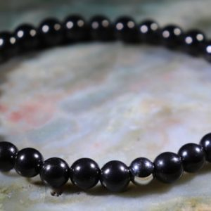 Shop Shungite Bracelets! Unisex Shungite Healing Stone Bracelet Or Anklet With Positive Healing Energy! | Natural genuine Shungite bracelets. Buy crystal jewelry, handmade handcrafted artisan jewelry for women.  Unique handmade gift ideas. #jewelry #beadedbracelets #beadedjewelry #gift #shopping #handmadejewelry #fashion #style #product #bracelets #affiliate #ad