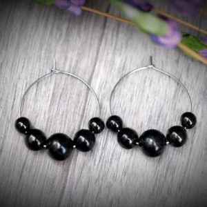 Shop Shungite Earrings! Petrovsky Shungite Healing & Emf 5g Protection 10mm 8mm 6mm Round Black Bead Stainless Steel Hoop Earrings | Natural genuine Shungite earrings. Buy crystal jewelry, handmade handcrafted artisan jewelry for women.  Unique handmade gift ideas. #jewelry #beadedearrings #beadedjewelry #gift #shopping #handmadejewelry #fashion #style #product #earrings #affiliate #ad