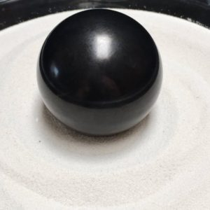 Shop Shungite Stones & Crystals! Polished Shungite Sphere – A Beautiful Ball of Fullerenes! (6-2, 64mm) | Natural genuine stones & crystals in various shapes & sizes. Buy raw cut, tumbled, or polished gemstones for making jewelry or crystal healing energy vibration raising reiki stones. #crystals #gemstones #crystalhealing #crystalsandgemstones #energyhealing #affiliate #ad