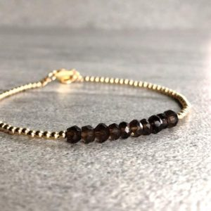 Shop Smoky Quartz Bracelets! Smoky Quartz Bead Bracelet | Brown Crystal Jewelry | Faceted Gemstone Bracelet | Tiny Silver Or Gold Ball Beads | Natural genuine Smoky Quartz bracelets. Buy crystal jewelry, handmade handcrafted artisan jewelry for women.  Unique handmade gift ideas. #jewelry #beadedbracelets #beadedjewelry #gift #shopping #handmadejewelry #fashion #style #product #bracelets #affiliate #ad