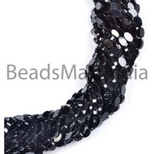 Shop Spinel Bead Shapes! Smooth Black Spinel Plain Oval Gemstone Beads, Flat Oval, Black Spinel Gemstone Beads, Black Spinel Beads, Black Spinel | Natural genuine other-shape Spinel beads for beading and jewelry making.  #jewelry #beads #beadedjewelry #diyjewelry #jewelrymaking #beadstore #beading #affiliate #ad