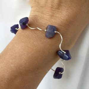 Shop Tanzanite Bracelets! Playful Partners – A Tanzanite and Rhodium Plated Sterling Silver Bracelet (1-A) | Natural genuine Tanzanite bracelets. Buy crystal jewelry, handmade handcrafted artisan jewelry for women.  Unique handmade gift ideas. #jewelry #beadedbracelets #beadedjewelry #gift #shopping #handmadejewelry #fashion #style #product #bracelets #affiliate #ad