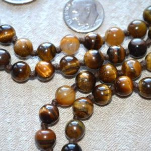 Shop Tiger Eye Necklaces! Protection Tiger Eye Mala Beads 108 Tigereye Mala Necklace Knotted Tiger Eye Mala Beads 6 / 8/ 10 mm Tiger Eye Mala Necklace for Protection | Natural genuine Tiger Eye necklaces. Buy crystal jewelry, handmade handcrafted artisan jewelry for women.  Unique handmade gift ideas. #jewelry #beadednecklaces #beadedjewelry #gift #shopping #handmadejewelry #fashion #style #product #necklaces #affiliate #ad