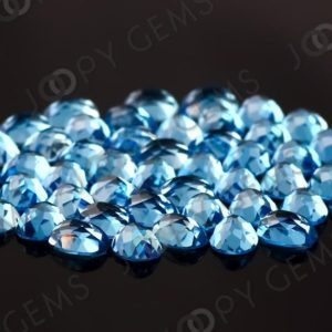 Shop Topaz Cabochons! Swiss Blue Topaz Rose Cut Oval Cabochon 8x6mm – per stone | Natural genuine stones & crystals in various shapes & sizes. Buy raw cut, tumbled, or polished gemstones for making jewelry or crystal healing energy vibration raising reiki stones. #crystals #gemstones #crystalhealing #crystalsandgemstones #energyhealing #affiliate #ad