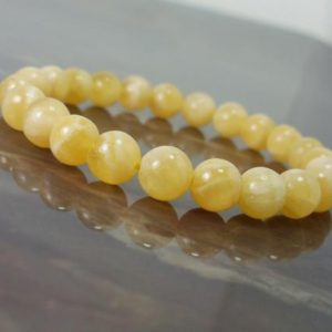 Shop Calcite Bracelets! Yellow Calcite  Bracelet, Natural Gemstone Bracelet, Unisex Women Men Bracelet + Gift Box, Beaded Bracelet | Natural genuine Calcite bracelets. Buy crystal jewelry, handmade handcrafted artisan jewelry for women.  Unique handmade gift ideas. #jewelry #beadedbracelets #beadedjewelry #gift #shopping #handmadejewelry #fashion #style #product #bracelets #affiliate #ad
