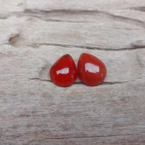 Shop Carnelian Cabochons! Pair Carnelian cabochon 9x7mm | Natural genuine stones & crystals in various shapes & sizes. Buy raw cut, tumbled, or polished gemstones for making jewelry or crystal healing energy vibration raising reiki stones. #crystals #gemstones #crystalhealing #crystalsandgemstones #energyhealing #affiliate #ad