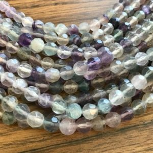 Shop Fluorite Faceted Beads! Natural Fluorite 8mm Faceted Round Gemstone Bead–15 inch strand- | Natural genuine faceted Fluorite beads for beading and jewelry making.  #jewelry #beads #beadedjewelry #diyjewelry #jewelrymaking #beadstore #beading #affiliate #ad