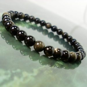 Shop Golden Obsidian Bracelets! Gold sheen Obsidian 6mm Bracelet, Natural Gemstone Bracelet, Black Bracelet, Unisex Women Men Bracelet, Beaded Bracelet +Gift Bag | Natural genuine Golden Obsidian bracelets. Buy crystal jewelry, handmade handcrafted artisan jewelry for women.  Unique handmade gift ideas. #jewelry #beadedbracelets #beadedjewelry #gift #shopping #handmadejewelry #fashion #style #product #bracelets #affiliate #ad