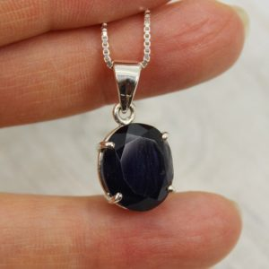 Shop Iolite Pendants! A beauty…dark blue Iolite pendant faceted cut oval shape stone set on 925e sterling silver mount great quality silver natural blue Iolite | Natural genuine Iolite pendants. Buy crystal jewelry, handmade handcrafted artisan jewelry for women.  Unique handmade gift ideas. #jewelry #beadedpendants #beadedjewelry #gift #shopping #handmadejewelry #fashion #style #product #pendants #affiliate #ad