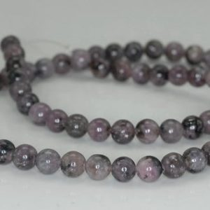 Shop Lepidolite Beads! 6mm Black Purple Lepidolite Gemstone Grade Ab Round Loose Beads 16 Inch Full Strand (90188374-650) | Natural genuine round Lepidolite beads for beading and jewelry making.  #jewelry #beads #beadedjewelry #diyjewelry #jewelrymaking #beadstore #beading #affiliate #ad