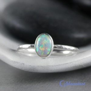 Shop Opal Rings! Dainty Oval Opal Promise Ring in Sterling Silver | Moonkist Designs | Natural genuine Opal rings, simple unique handcrafted gemstone rings. #rings #jewelry #shopping #gift #handmade #fashion #style #affiliate #ad