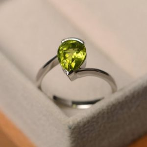 Natural peridot ring, peat cut engagement ring, sterling silver ring, green gemstone ring, August birthstone ring, solitaire ring | Natural genuine Array rings, simple unique alternative gemstone engagement rings. #rings #jewelry #bridal #wedding #jewelryaccessories #engagementrings #weddingideas #affiliate #ad