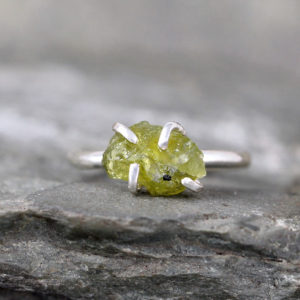 Shop Peridot Rings! Peridot Sterling Silver Ring – Raw Uncut Rough Peridot – Green Gemstone Ring – August Birthstone Ring – Peridot Stacking Ring | Natural genuine Peridot rings, simple unique handcrafted gemstone rings. #rings #jewelry #shopping #gift #handmade #fashion #style #affiliate #ad