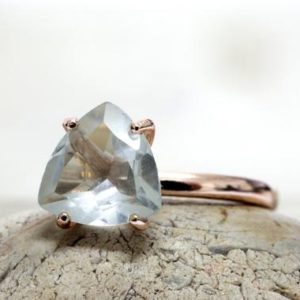 Shop Quartz Crystal Jewelry! Crystal quartz ring,trillion rose gold ring,stone ring,crystal ring,clear ring,bridal ring,triangle ring | Natural genuine Quartz jewelry. Buy handcrafted artisan wedding jewelry.  Unique handmade bridal jewelry gift ideas. #jewelry #beadedjewelry #gift #crystaljewelry #shopping #handmadejewelry #wedding #bridal #jewelry #affiliate #ad
