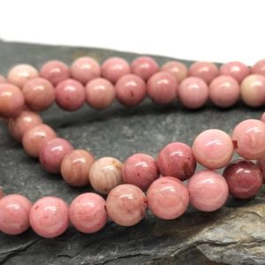 Natural Rhodonite round Beads 6 8 or 10 mm Light  Peach pink salmon Gemstone Beads | Natural genuine round Rhodonite beads for beading and jewelry making.  #jewelry #beads #beadedjewelry #diyjewelry #jewelrymaking #beadstore #beading #affiliate #ad
