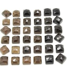 Shop Smoky Quartz Cabochons! Smoky quartz gemstone,gemstones wholesale,square cabochons,bulk cabochons,faceted cabochons,loose gemstones,precious stones,AA Quality | Natural genuine stones & crystals in various shapes & sizes. Buy raw cut, tumbled, or polished gemstones for making jewelry or crystal healing energy vibration raising reiki stones. #crystals #gemstones #crystalhealing #crystalsandgemstones #energyhealing #affiliate #ad