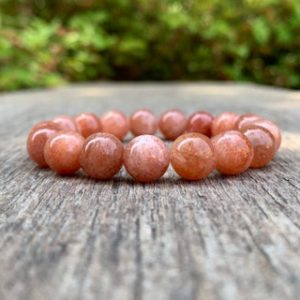 Shop Sunstone Bracelets! Chunky Golden Sunstone Bracelet Handmade 10mm Golden Sunstone Beaded Gemstone Bracelet Gold Orange Sunstone Bracelet Stack Bracelet   Natural genuine Sunstone bracelets. Buy crystal jewelry, handmade handcrafted artisan jewelry for women.  Unique handmade gift ideas. #jewelry #beadedbracelets #beadedjewelry #gift #shopping #handmadejewelry #fashion #style #product #bracelets #affiliate #ad