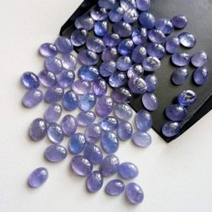 Shop Tanzanite Stones & Crystals! 5x7mm – 6x8mm Tanzanite Plain Cabochons, Natural Tanzanite Plain Oval Flat Back Cabochons For Jewelry (5Pcs To 10Pcs Options) – PDG197 | Natural genuine stones & crystals in various shapes & sizes. Buy raw cut, tumbled, or polished gemstones for making jewelry or crystal healing energy vibration raising reiki stones. #crystals #gemstones #crystalhealing #crystalsandgemstones #energyhealing #affiliate #ad