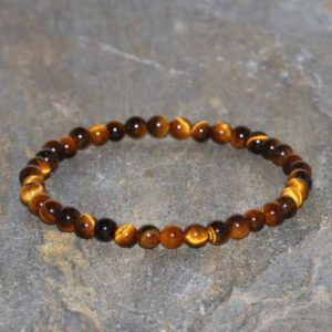 Shop Tiger Eye Bracelets! Dainty Tiger's Eye Beaded Bracelet Handmade Grade AAA 4mm Naural Unisex Bracelet Stack Bracelet Beaded Gift Bracelet Clarity Bracelet | Natural genuine Tiger Eye bracelets. Buy crystal jewelry, handmade handcrafted artisan jewelry for women.  Unique handmade gift ideas. #jewelry #beadedbracelets #beadedjewelry #gift #shopping #handmadejewelry #fashion #style #product #bracelets #affiliate #ad