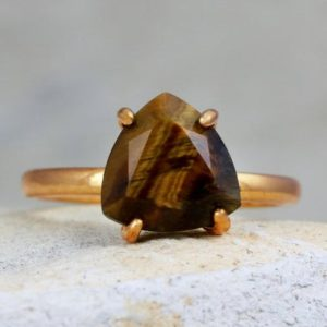 Shop Tiger Eye Jewelry! Tiger Eye Ring, rose Gold Ring, delicate Prong Ring, stacking Ring, gemstone Ring, trillion Ring, triangle Ring | Natural genuine Tiger Eye jewelry. Buy crystal jewelry, handmade handcrafted artisan jewelry for women.  Unique handmade gift ideas. #jewelry #beadedjewelry #beadedjewelry #gift #shopping #handmadejewelry #fashion #style #product #jewelry #affiliate #ad