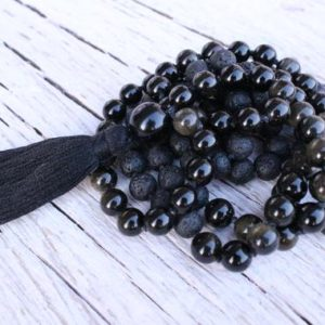 Shop Golden Obsidian Jewelry! 108 Black Golden Obsidian, Lava Stone  Mala,Royal Obsidian , Cotton Tassel. Vegan  Unisex Mala. | Natural genuine Golden Obsidian jewelry. Buy crystal jewelry, handmade handcrafted artisan jewelry for women.  Unique handmade gift ideas. #jewelry #beadedjewelry #beadedjewelry #gift #shopping #handmadejewelry #fashion #style #product #jewelry #affiliate #ad