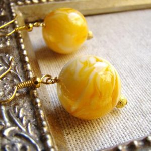 Shop Amber Earrings! SALE Round Amber 20 mm Gold Earrings Sunshine.  Round yellow dangle drops.  Gifts under 20 | Natural genuine Amber earrings. Buy crystal jewelry, handmade handcrafted artisan jewelry for women.  Unique handmade gift ideas. #jewelry #beadedearrings #beadedjewelry #gift #shopping #handmadejewelry #fashion #style #product #earrings #affiliate #ad