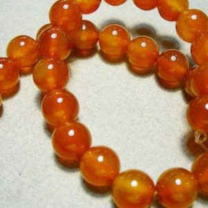 Shop Carnelian Round Beads! Carnelian Beads Gemstone Round 10mm | Natural genuine round Carnelian beads for beading and jewelry making.  #jewelry #beads #beadedjewelry #diyjewelry #jewelrymaking #beadstore #beading #affiliate #ad