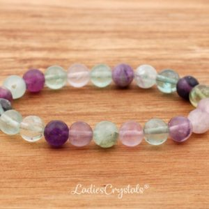 Shop Fluorite Bracelets! 8mm Rainbow Fluorite Bracelet, Green fluorite Bracelets 8 mm, Fluorite Bracelets, Fluorite Bead Bracelet, Fluorite Crystals, Gift, Healing | Natural genuine Fluorite bracelets. Buy crystal jewelry, handmade handcrafted artisan jewelry for women.  Unique handmade gift ideas. #jewelry #beadedbracelets #beadedjewelry #gift #shopping #handmadejewelry #fashion #style #product #bracelets #affiliate #ad