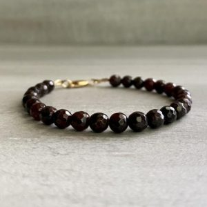 Shop Garnet Bracelets! Faceted Garnet Bracelet | Sterling Silver or Gold Clasp | Dark Garnet Gemstone Jewelry for Women, Men | Natural genuine Garnet bracelets. Buy crystal jewelry, handmade handcrafted artisan jewelry for women.  Unique handmade gift ideas. #jewelry #beadedbracelets #beadedjewelry #gift #shopping #handmadejewelry #fashion #style #product #bracelets #affiliate #ad
