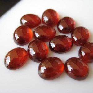Shop Garnet Cabochons! 10 Pieces 10x8mm Hessonite Garnet Smooth Oval Shaped Flat Back Loose Cabochons BB329 | Natural genuine stones & crystals in various shapes & sizes. Buy raw cut, tumbled, or polished gemstones for making jewelry or crystal healing energy vibration raising reiki stones. #crystals #gemstones #crystalhealing #crystalsandgemstones #energyhealing #affiliate #ad