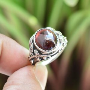 Shop Garnet Rings! Sterling Silver Garnet Ring, 10×12 mm Oval Garnet Ring, Designer Oval Garnet Ring, Garnet Engagement Ring, Garnet Ring, Garnet Ring Silver | Natural genuine Garnet rings, simple unique alternative gemstone engagement rings. #rings #jewelry #bridal #wedding #jewelryaccessories #engagementrings #weddingideas #affiliate #ad