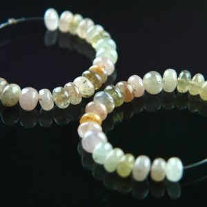 Shop Yellow Sapphire Beads! Genuine Sapphire Yellow and Green Smooth Rondelle Beads Natural Pastel Colors Semiprecious Stones Partial Strand Opaque to Translucent 5.5mm | Natural genuine rondelle Yellow Sapphire beads for beading and jewelry making.  #jewelry #beads #beadedjewelry #diyjewelry #jewelrymaking #beadstore #beading #affiliate #ad