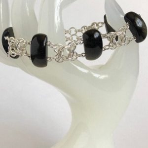 Shop Golden Obsidian Bracelets! Black Golden Obsidian Bracelet, with Sterling Silver Chainmaille | Natural genuine Golden Obsidian bracelets. Buy crystal jewelry, handmade handcrafted artisan jewelry for women.  Unique handmade gift ideas. #jewelry #beadedbracelets #beadedjewelry #gift #shopping #handmadejewelry #fashion #style #product #bracelets #affiliate #ad