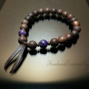 Shop Lepidolite Bracelets! Mens Sandalwood Bracelet, Purple Lepidolite Gemstone Bracelet, Leather Wrist Mala, Chakra Bracelet, Healing Bracelet, Fragrance | Natural genuine Lepidolite bracelets. Buy handcrafted artisan men's jewelry, gifts for men.  Unique handmade mens fashion accessories. #jewelry #beadedbracelets #beadedjewelry #shopping #gift #handmadejewelry #bracelets #affiliate #ad