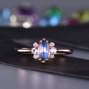 Shop Moonstone Engagement Rings! Marquise Cut Moonstone Engagement Ring Rose Gold  Unique Moonstone Ring Plain Gold Band Anniversary Christmas Gifts | Natural genuine Moonstone rings, simple unique alternative gemstone engagement rings. #rings #jewelry #bridal #wedding #jewelryaccessories #engagementrings #weddingideas #affiliate #ad