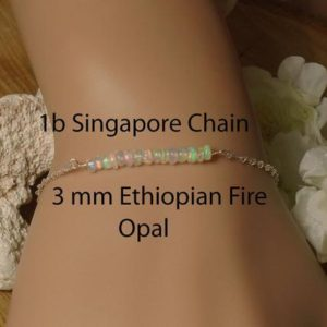 Shop Opal Bracelets! Tiny Ethiopian Fire Opal Personalized Bracelet /Yellow or Rose Gold Filled/ Sterling Silver/ Natural AAA+++ Ethiopian Fire Opal / Minimalist | Natural genuine Opal bracelets. Buy crystal jewelry, handmade handcrafted artisan jewelry for women.  Unique handmade gift ideas. #jewelry #beadedbracelets #beadedjewelry #gift #shopping #handmadejewelry #fashion #style #product #bracelets #affiliate #ad